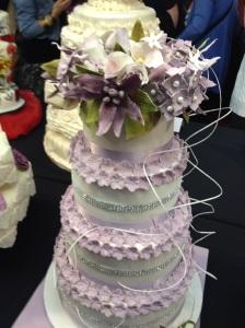 Cake International purple ruffle wedding cake