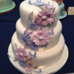Cake International purple flower tier cake