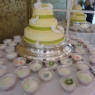 Green wedding cake and cupcakes